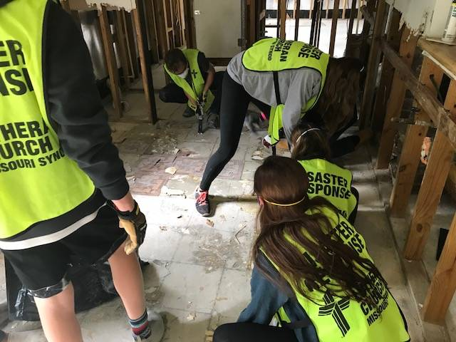 Students of Faith Lutheran Middle & High School get busy clearing out damage from homes in the Houston area that were affected by Hurricane Harvey. In some places, the water had gotten shoulde ...
