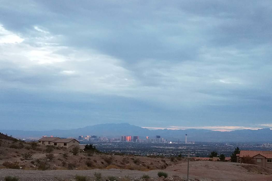 Clouds hang over the Las Vegas Valley in a view from east Lake Mead Boulevard. (Mike Shoro/Las Vegas Review-Journal)