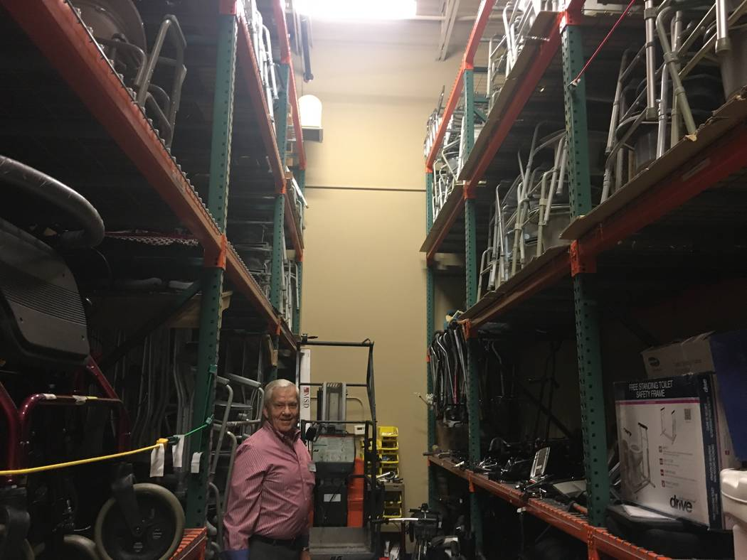 West stands underneath the shelves of medical equipment stored in the foundation's warehouse at 2460 Hampton Road in Sun City Anthem. (Diego Mendoza-Moyers/View) @dmendozamoyers