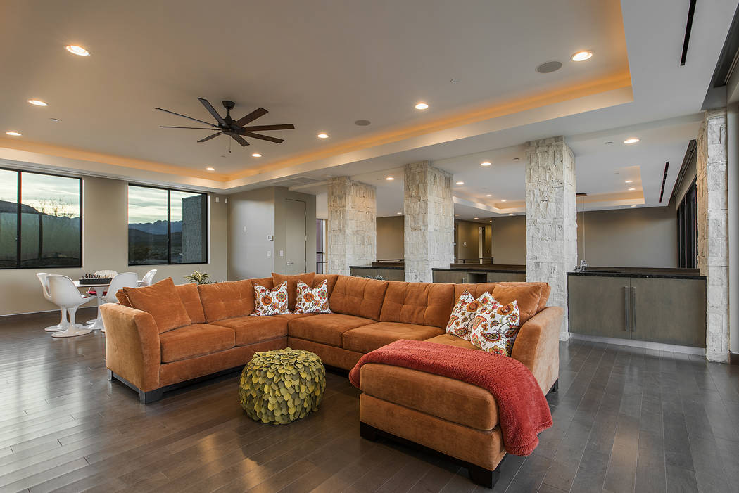 Shapiro & Sher Group The living room furniture adds a pop of color.
