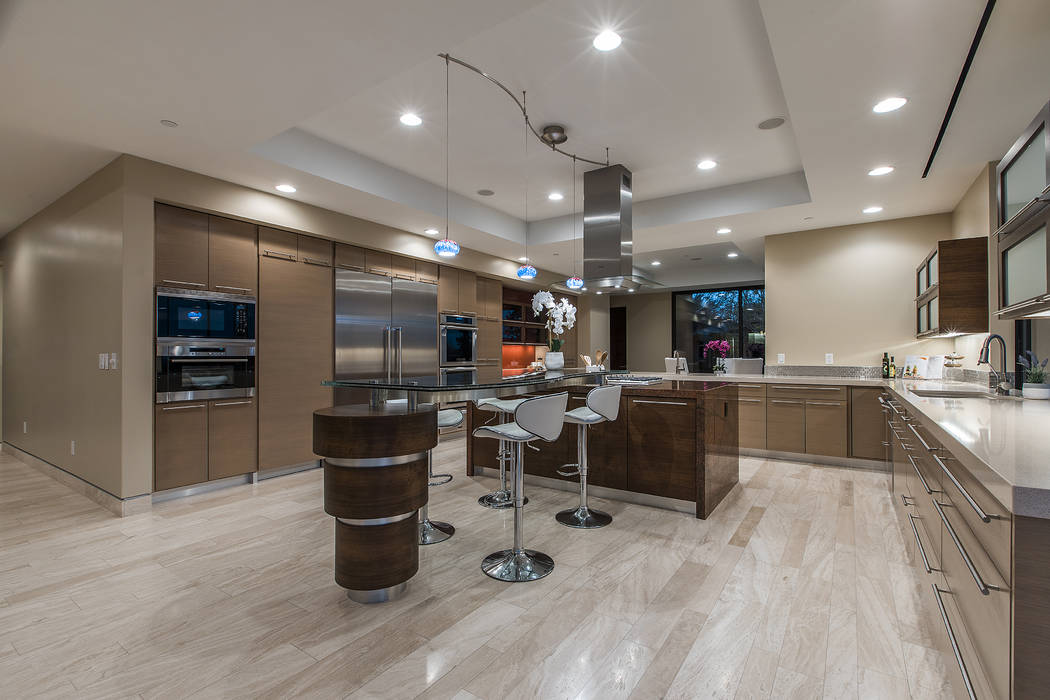Shapiro & Sher Group The contemporary gourmet kitchen, adjacent to the formal sitting area features professional grade stainless steel appliances.