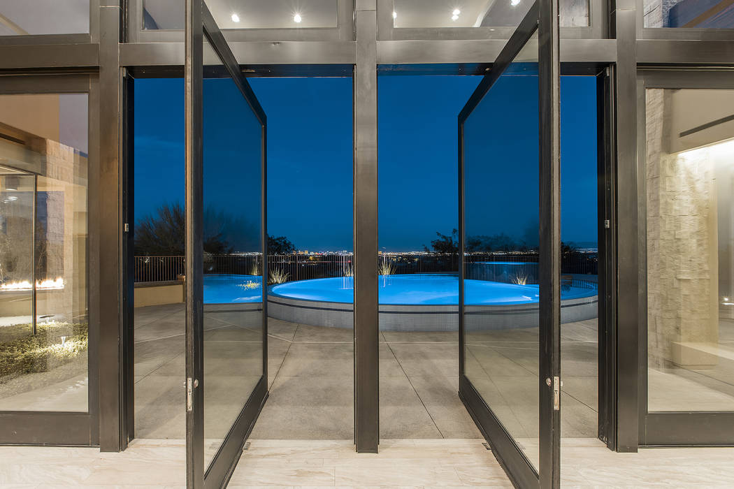 Shapiro & Sher Group The back doors open to the pool.