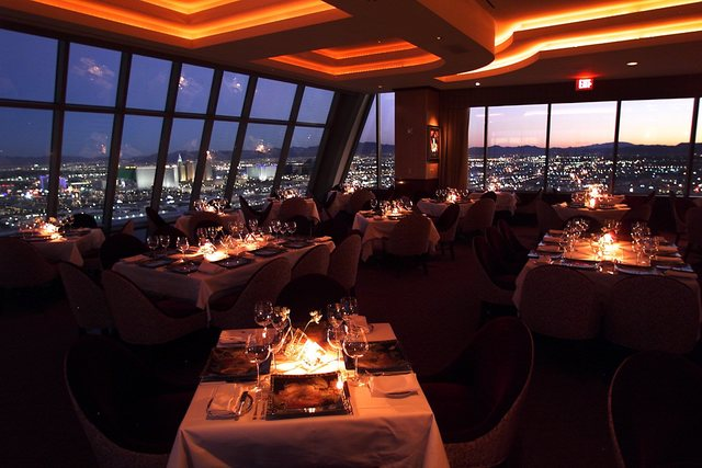 An Interior View Of Alize Restaurant Overlooking The Las Vegas Strip At Sunset Atop