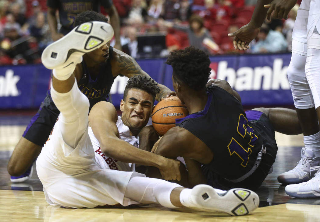 UNLV's Jay Green and Prairie View A&M's Iwin Ellis (13) fight for the ball during their basketball game at Thomas & Mack Center in Las Vegas on Wednesday, Nov. 15, 2017. Chase Stevens Las  ...