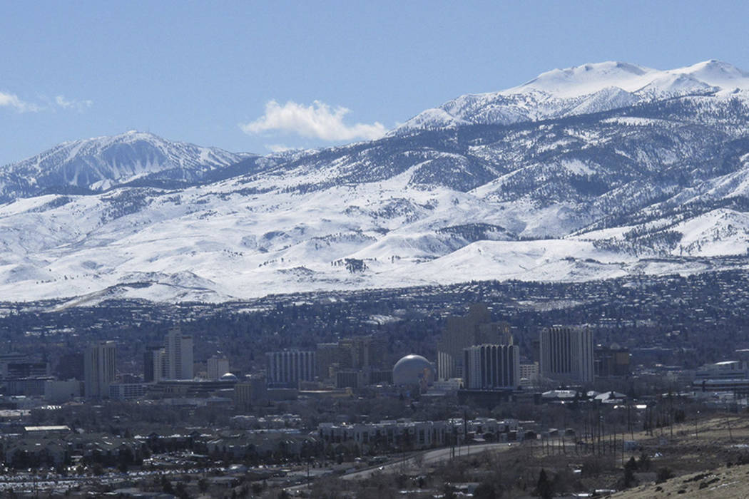Sunshine prevailed across the snow-covered Sierra foothills and ridge tops halfway between Reno and Lake Tahoe to the southwest in this photo taken in Reno, Nevada. (AP file photo/By Scott Sonner).