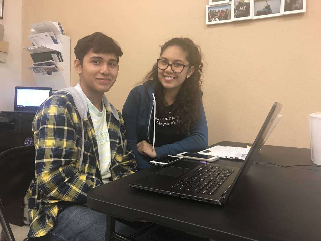 Las Vegas High seniors Elvin Recinos and Wendy Pena, Wednesday, Nov. 15, 2017, at the Leaders in Training program in Las Vegas, which allows time for students to complete college applications. Ame ...