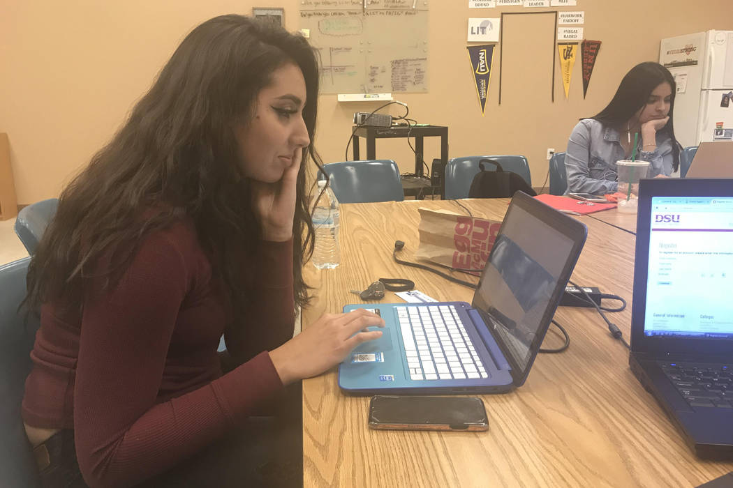 Las Vegas High School senior Michelle Gonzalez completes college applications, Wednesday Nov. 15, 2017, at the Leaders in Training nonprofit in Las Vegas that helps first-generation college studen ...