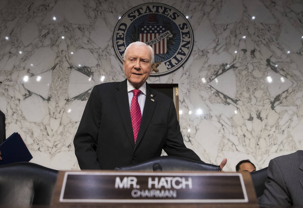 In this Nov. 13, 2017, photo, Senate Finance Committee Chairman Orrin Hatch, R-Utah, arrives as the tax-writing panel begins work on overhauling the nation's tax code, on Capitol Hill in Washingto ...