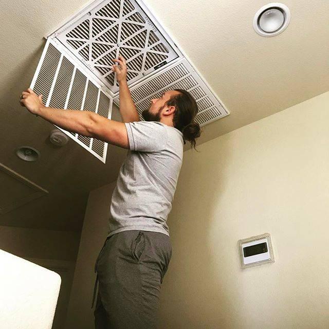 JC Pauli changes an air duct filter. (Blue Diamond Air Solutions Instagram)