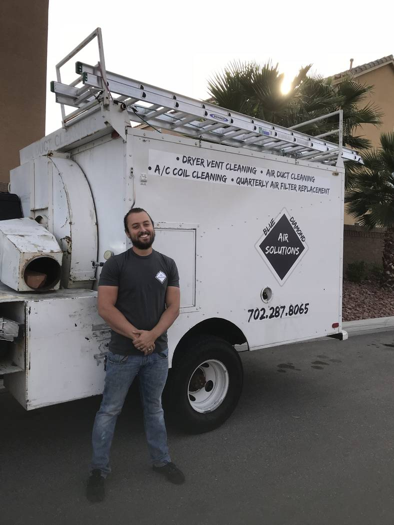 JC Pauli in front of the Blue Diamond Air Solutions company truck. (Courtesy  JC Pauli)