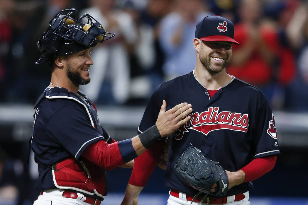 In this Sept. 12, 2017, file photo, Cleveland Indians starting pitcher Corey Kluber, right, and catcher Yan Gomes celebrate the team's 2-0 victory over the Detroit Tigers in a baseball game in Cle ...