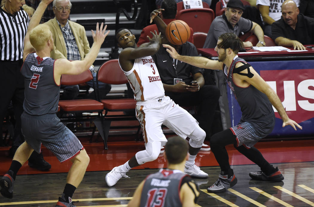 UNLV Rebels guard Amauri Hardy (3) has the ball knocked away by Eastern Washington Eagles forward Jesse Hunt (34) during their game Friday, November 17, 2017, at the Thomas & Mack Center. UNLV ...