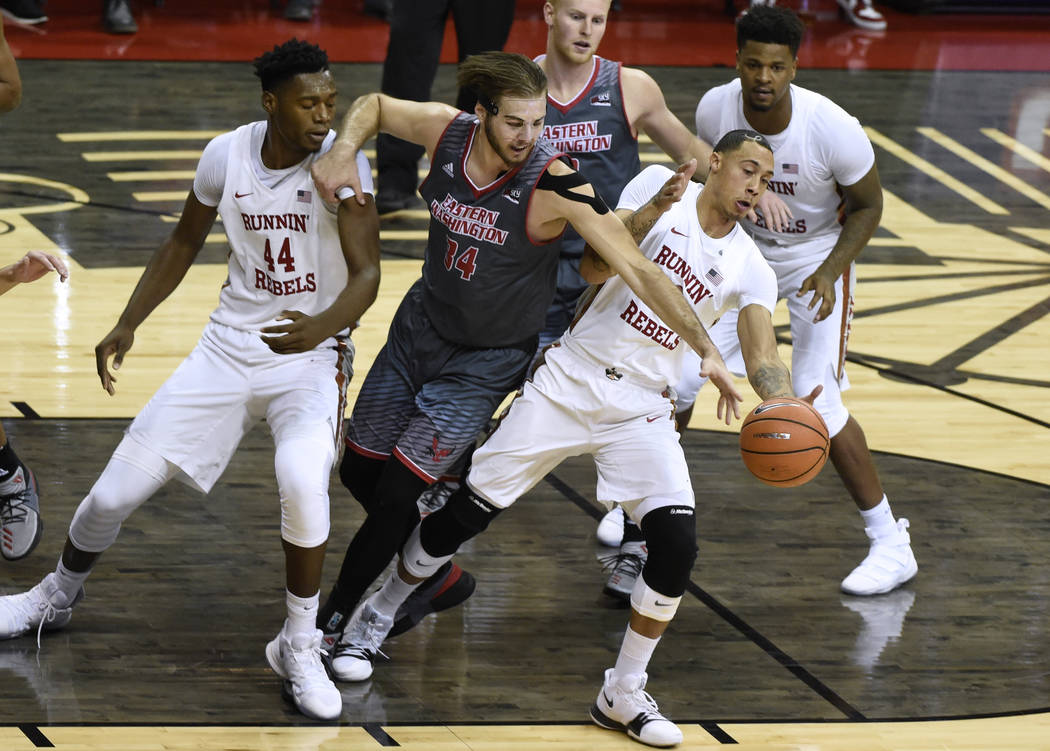 UNLV Rebels forward Anthony Smith (2) grabs a rebound from Eastern Washington Eagles forward Jesse Hunt (34) during their game Friday, November 17, 2017, at the Thomas & Mack Center. UNLV won  ...