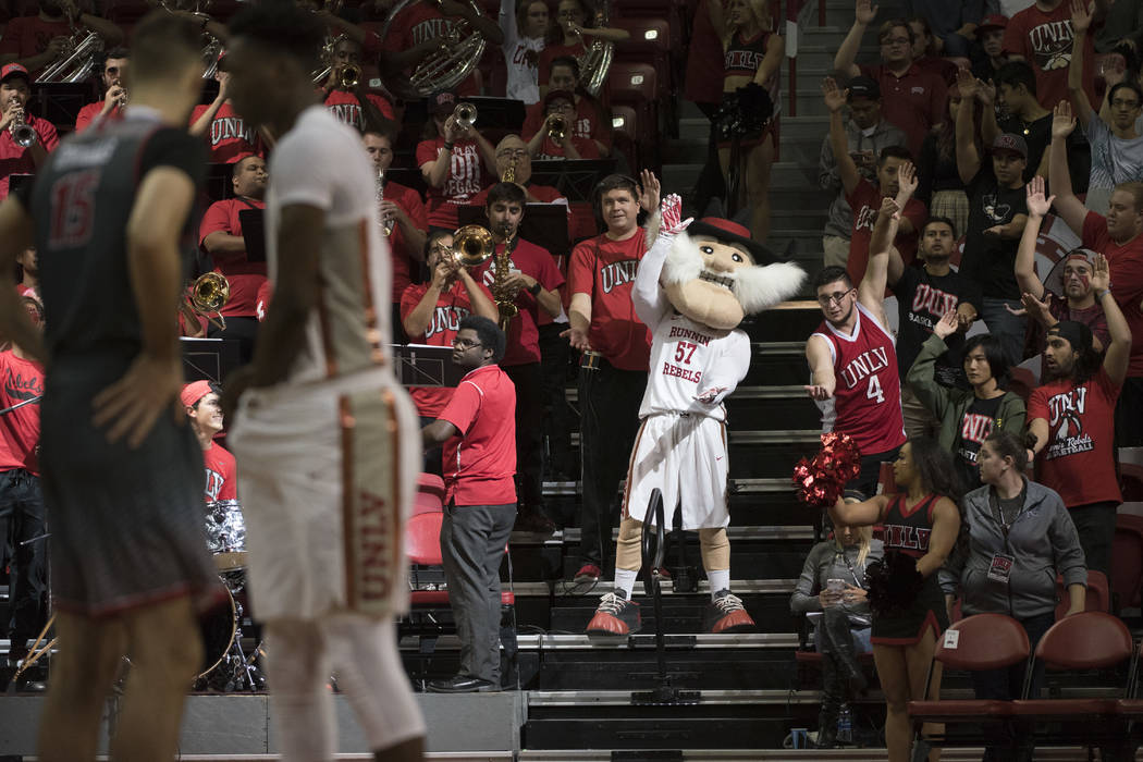 """Hey Reb and fans do their """"shark chomp"""" during their game against the Eastern Washington Eagles Friday, November 17, 2017, at the Thomas & Mack Center. UNLV won the game 91-7 ..."""
