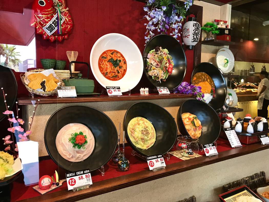 Replicas of dishes stand at the entrance of Cafe Sanuki noodle bar in Las Vegas, Wednesday, Nov. 15, 2017. Madelyn Reese View @MadelynGReese