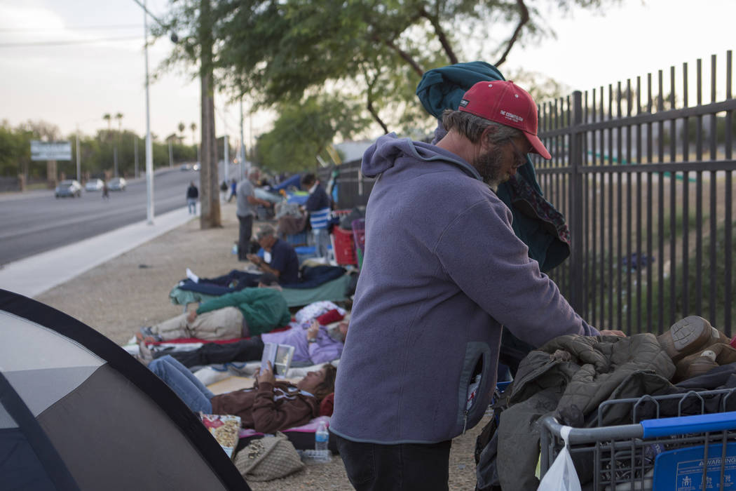 Mark Delmage, who is homeless, grabs a belongs from his cart, next to his tent where he stays along Las Vegas Boulevard near Foremaster Lane in Las Vegas, Friday, Nov. 17, 2017. Bridget Bennett La ...