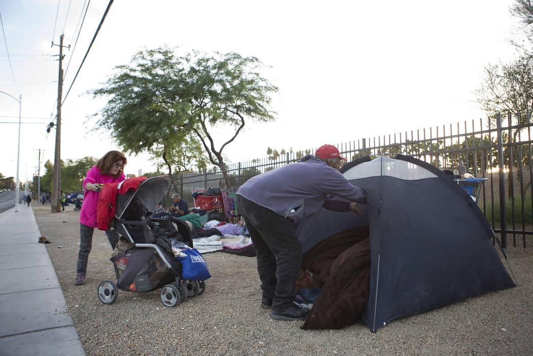 Jody Mathews, left, and Mark Delmage, who are homeless, prepare their tent along Las Vegas Boulevard near Foremaster Lane in Las Vegas, Friday, Nov. 17, 2017. Bridget Bennett Las Vegas Review-Jour ...