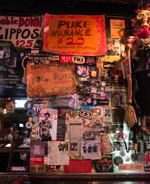 LAS VEGAS REVIEW-JOURNAL FILE Posters and stickers adorn the walls of the Double Down Saloon.