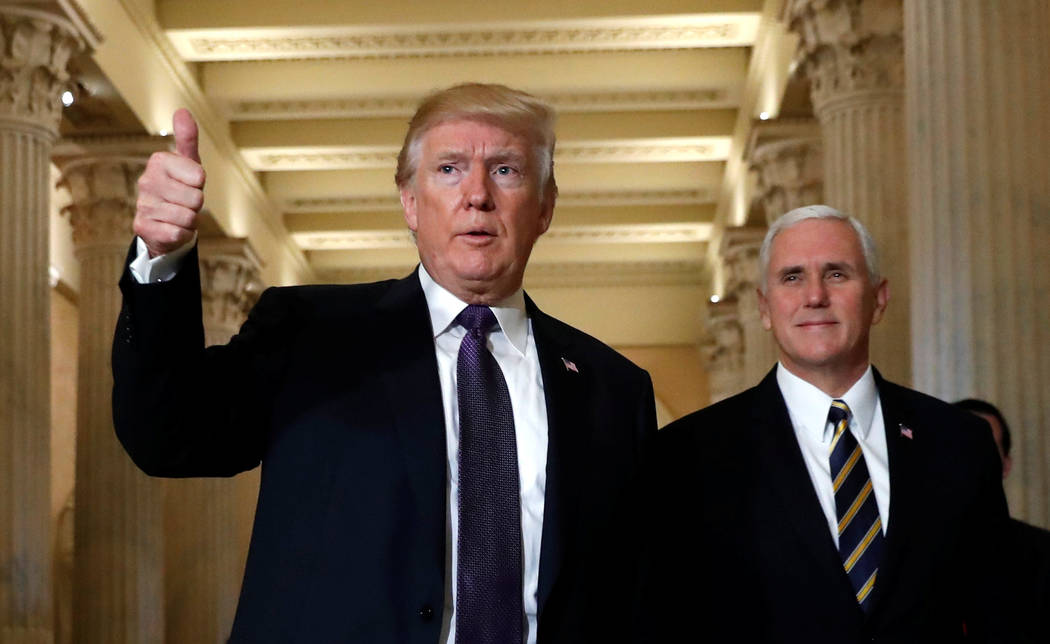 President Donald Trump gives a thumbs-up as he and Vice President Mike Pence depart the U.S. Capitol after a meeting to discuss tax legislation with House Republicans in Washington, Nov. 16, 2017. ...
