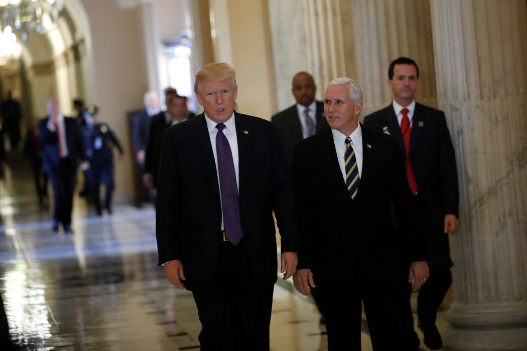 "President Donald Trump and Vice President Mike Pence depart the U.S. Capitol after meeting with House Republicans ahead of their vote on the ""Tax Cuts and Jobs Act"" in Washington, Nov. 16, 2017. ( ..."