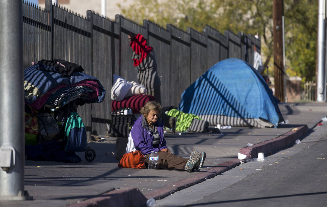 A homeless woman sits on the sidewalk on Foremaster Lane in Las Vegas, Wednesday, Nov. 22, 2017. Richard Brian Las Vegas Review-Journal @vegasphotograph