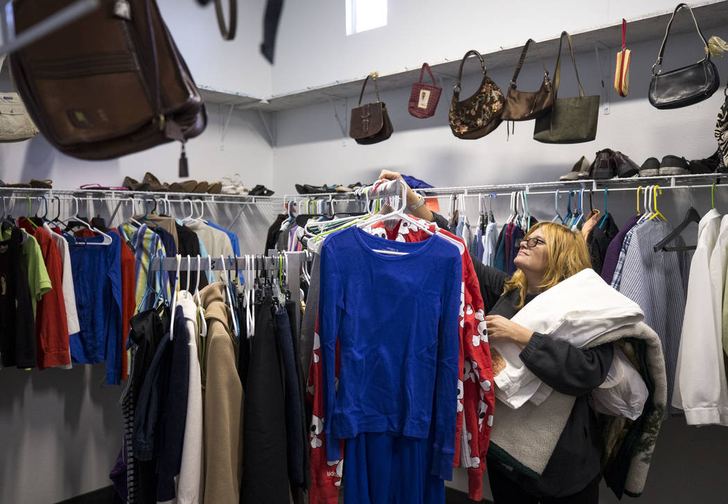 Edith Ann Freeman, who is currently homeless, looks for clothing at the CARE Complex on Foremaster Lane in Las Vegas, Wednesday, Nov. 22, 2017. Richard Brian Las Vegas Review-Journal @vegasphotograph