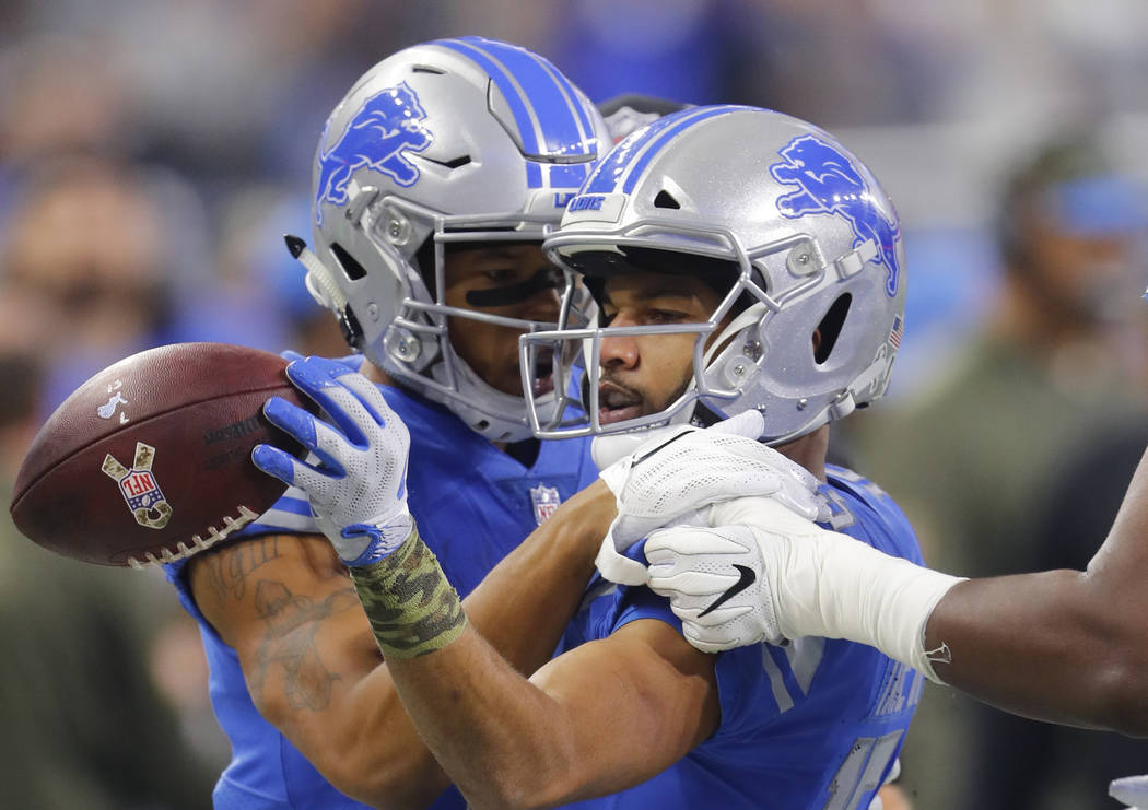 Detroit Lions wide receiver Golden Tate, right, celebrates a first down with Marvin Jones (11) against the Cleveland Browns during an NFL football game in Detroit, Sunday, Nov. 12, 2017. (AP Photo ...