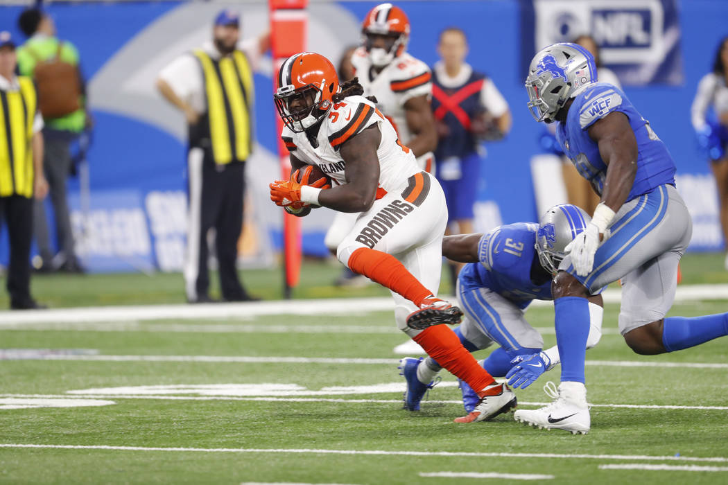 Cleveland Browns running back Isaiah Crowell (34) runs against the Detroit Lions during an NFL football game in Detroit, Sunday, Nov. 12, 2017. (AP Photo/Paul Sancya)