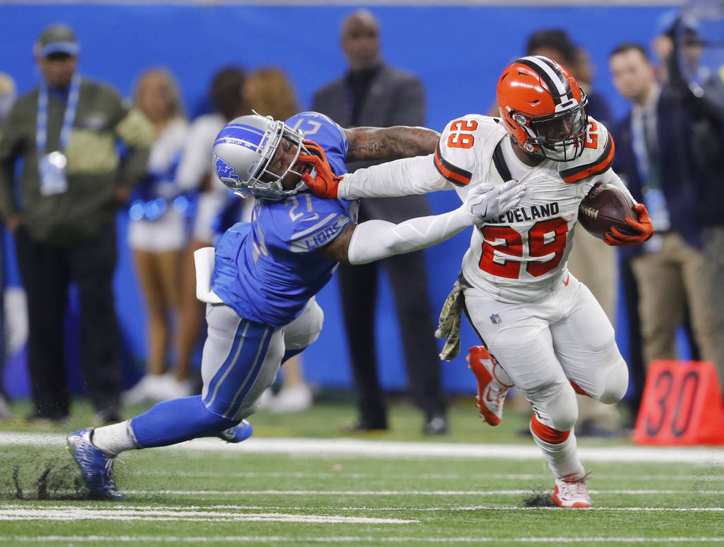 Cleveland Browns running back Duke Johnson (29) stiff arms Detroit Lions free safety Glover Quin (27) during an NFL football game in Detroit, Sunday, Nov. 12, 2017. (AP Photo/Paul Sancya)
