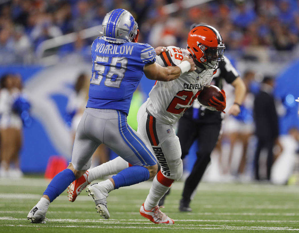 Detroit Lions outside linebacker Paul Worrilow (58) tries to tackle Cleveland Browns running back Duke Johnson (29) during an NFL football game in Detroit, Sunday, Nov. 12, 2017. (AP Photo/Paul Sa ...