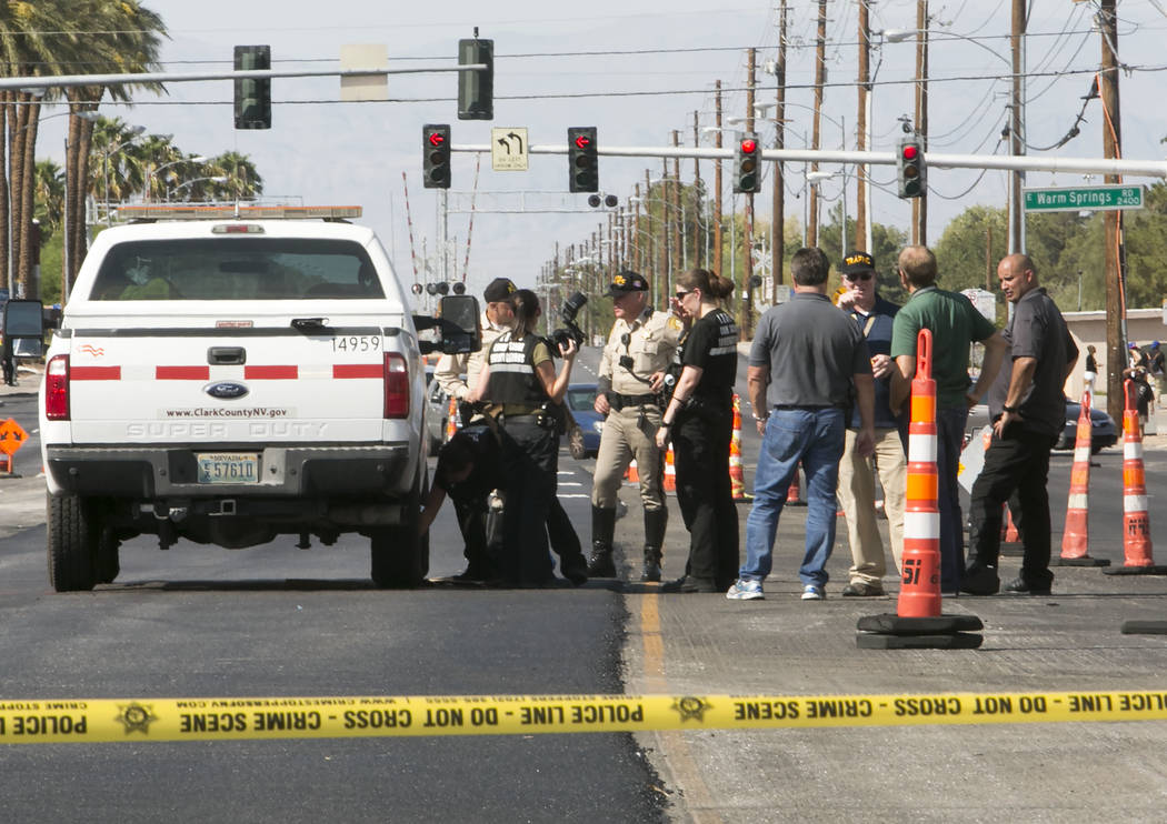 Las Vegas police investigate after a 65-year-old pedestrian was struck and killed by a Clark County vehicle at the intersection of Eastern Avenue and East Warm Springs Road on Tuesday, Sept. 5, 20 ...