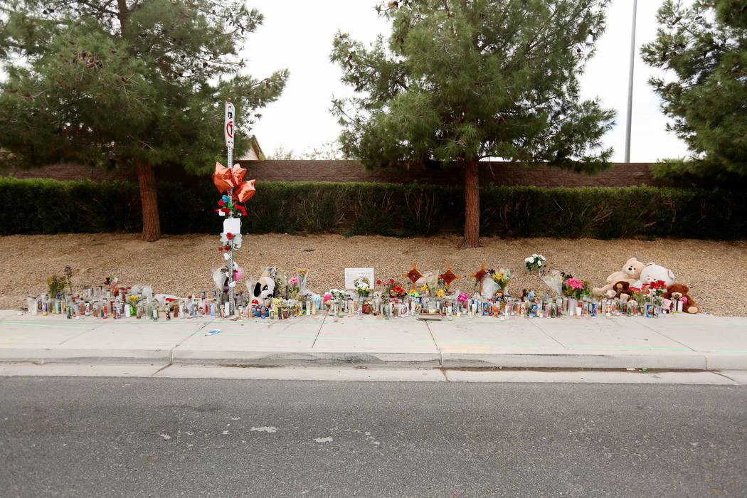 A memorial site on Wednesday, Oct. 18, 2017 where three juveniles between the ages of 12 and 15 were hit by a car on Desert Inn Road and east of Nellis Boulevard in Las Vegas. Elizabeth Brumley La ...