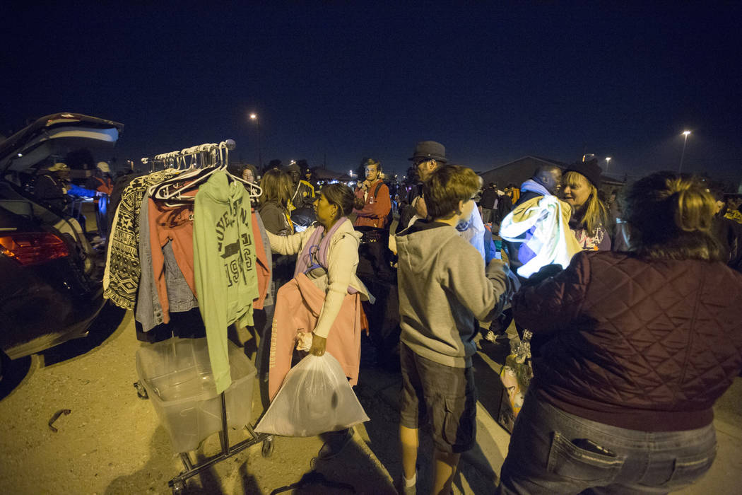 Individuals looks through clothes provided by the Compassion Initiate Las Vegas amongst other services off of H Street and Bonanza Road in Las Vegas, Monday, Nov. 20, 2017. Elizabeth Brumley Las V ...