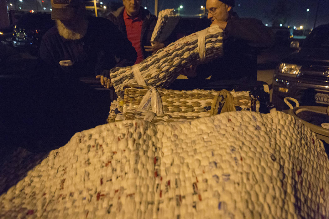 Plastic bag woven laying mats are distributed to individuals off of H Street and Bonanza Road in Las Vegas, Monday, Nov. 20, 2017. Elizabeth Brumley Las Vegas Review-Journal @EliPagePhoto