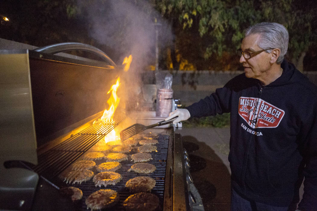Knights Of Columbus councilmen Tony Vito grills burgers at Our Lady of Las Vegas to be given out to individuals in need in Las Vegas, Monday, Nov. 20, 2017.  Elizabeth Brumley Las Vegas Review-Jou ...