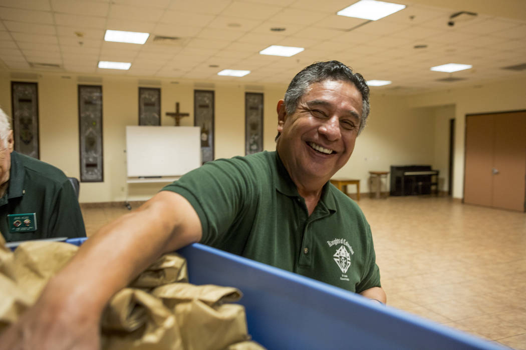 Knights Of Columbus councilmen Joe Suarez packs dinners at Our Lady of Las Vegas to be given out to individuals in need in Las Vegas, Monday, Nov. 20, 2017.  Elizabeth Brumley Las Vegas Review-Jou ...