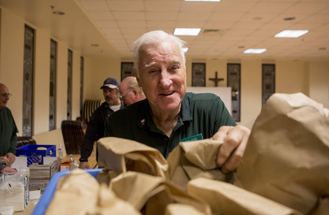 Knights Of Columbus councilmen John Hedge packs dinners at Our Lady of Las Vegas to be given out to individuals in need in Las Vegas, Monday, Nov. 20, 2017.  Elizabeth Brumley Las Vegas Review-Jou ...