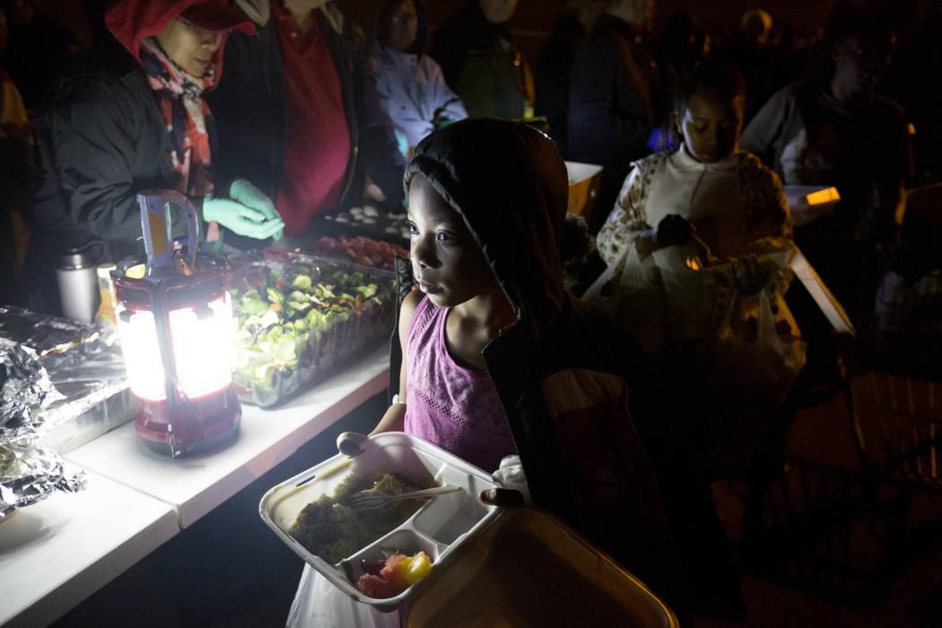 Aalaya Johnson, 11, is served food off of H Street and Bonanza Road in Las Vegas, Monday, Nov. 20, 2017.  Elizabeth Brumley Las Vegas Review-Journal @EliPagePhoto