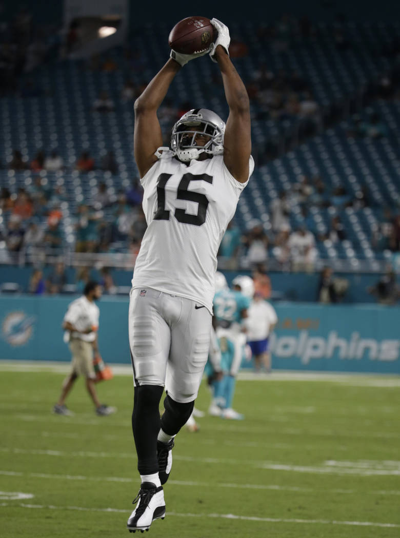 Oakland Raiders wide receiver Michael Crabtree (15) warms up before an NFL football game against the Miami Dolphins, Sunday, Nov. 5, 2017, in Miami Gardens, Fla. (AP Photo/Lynne Sladky)