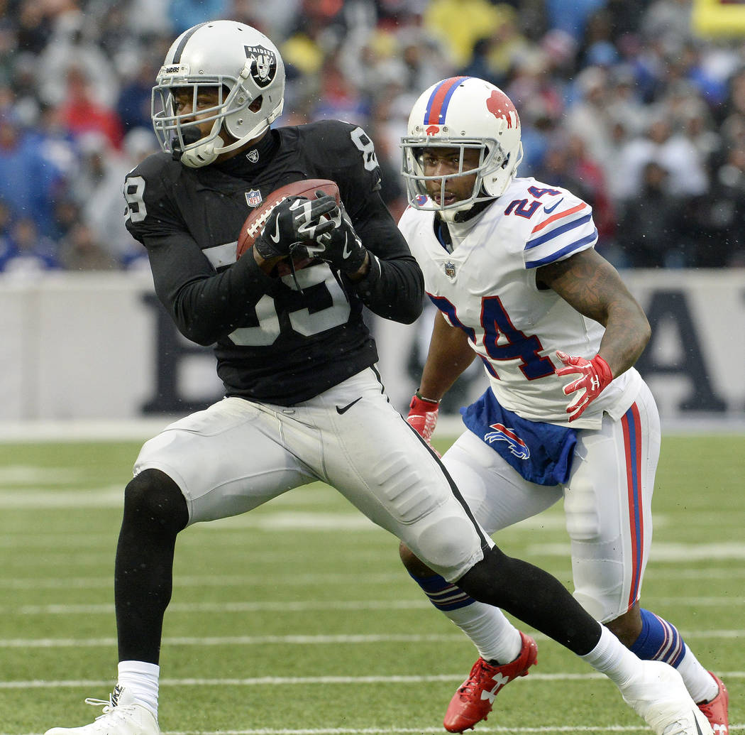 Oakland Raiders wide receiver Amari Cooper (89) makes a catch in front of Buffalo Bills cornerback Leonard Johnson (24) during the first half of an NFL football game, Sunday, Oct. 29, 2017, in Orc ...