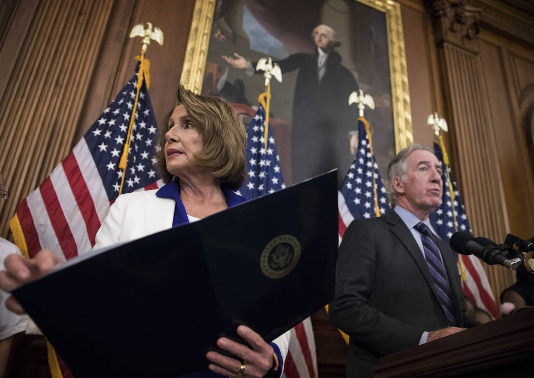 House Minority Leader Nancy Pelosi, D-Calif., left, and Rep. Richard Neal, D-Mass., the ranking member of the Ways and Means Committee, hold a news conference to dispute GOP claims about their tax ...