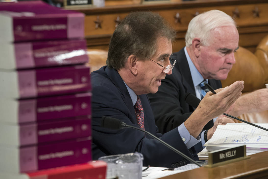 Rep. Jim Renacci, R-Ohio, joined at right by Rep. Pat Meehan, R-Pa., makes a point as the House Ways and Means Committee continues its debate over the Republican tax reform package, on Capitol Hil ...