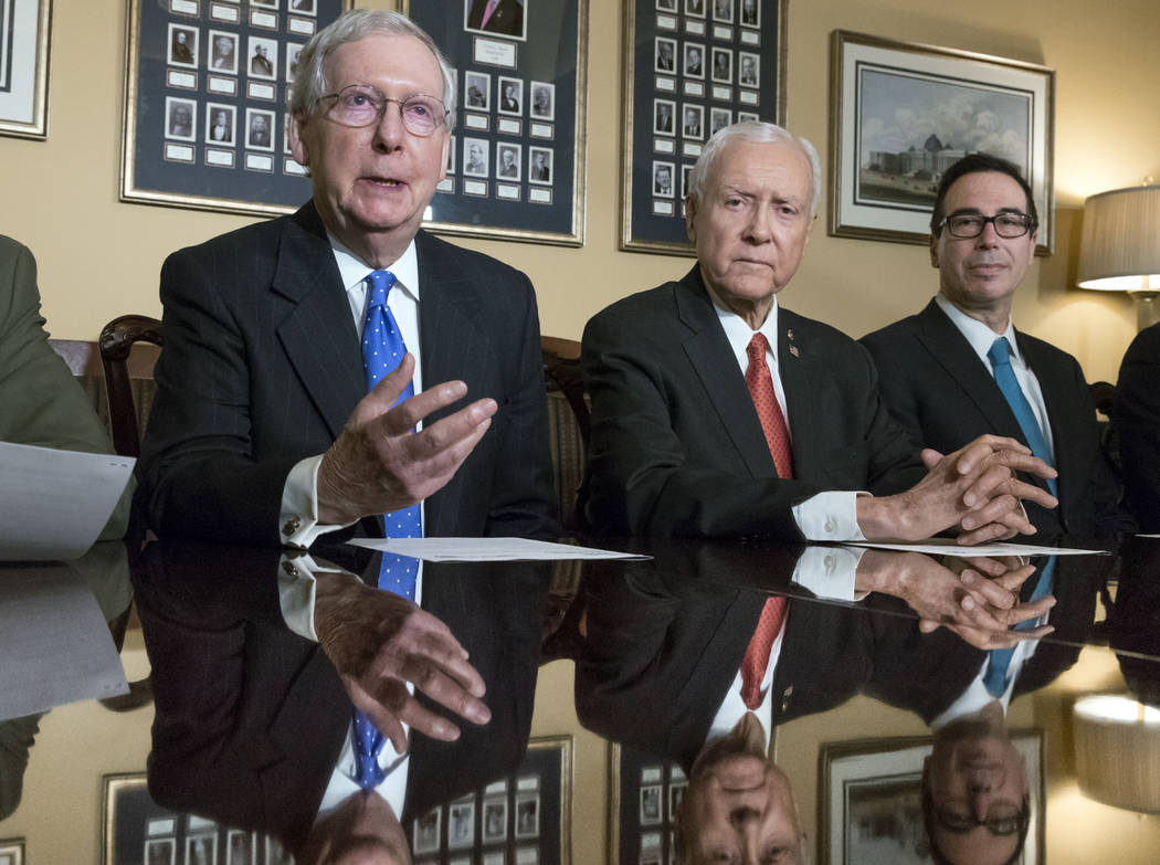 From left, Senate Majority Leader Mitch McConnell, R-Ky., Senate Finance Committee Chairman Orrin Hatch, R-Utah, and Treasury Secretary Steven Mnuchin, make statements to reporters as work gets un ...