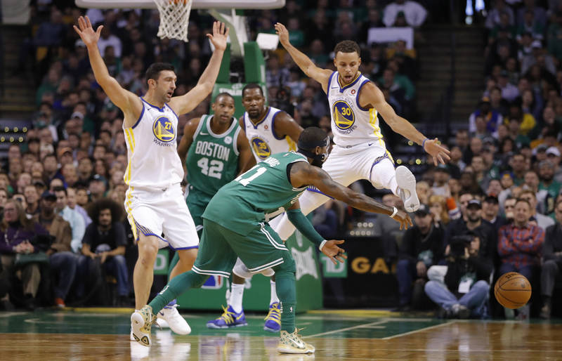 Nov 16, 2017; Boston, MA, USA; Boston Celtics guard Kyrie Irving (11) passes the ball as Golden State Warriors guard Stephen Curry (30) defends in the first quarter at TD Garden. Mandatory Credit: ...