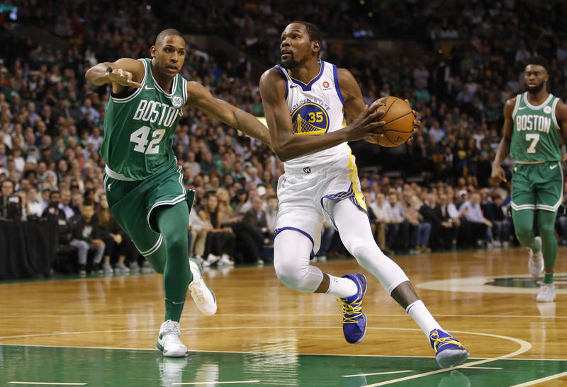 Nov 16, 2017; Boston, MA, USA; Golden State Warriors forward Kevin Durant (35) prepares to shoot the ball as Boston Celtics forward Al Horford (42) defends in the first quarter at TD Garden. Manda ...