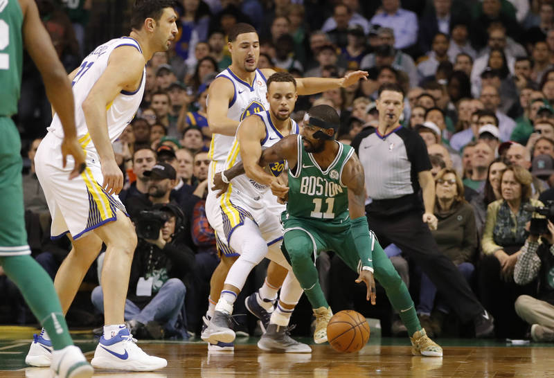 Nov 16, 2017; Boston, MA, USA; Boston Celtics guard Kyrie Irving (11) dribbles the ball as Golden State Warriors guard Stephen Curry (30) defends in the first quarter at TD Garden. Mandatory Credi ...