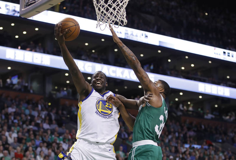 Nov 16, 2017; Boston, MA, USA; Golden State Warriors forward Draymond Green (23) drives to the basket as Boston Celtics guard Marcus Smart (36) defends in the second quarter at TD Garden. Mandator ...
