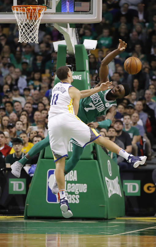 Nov 16, 2017; Boston, MA, USA; Golden State Warriors guard Klay Thompson (11) blocks Boston Celtics guard Jaylen Brown (7) in the second quarter at TD Garden. Mandatory Credit: David Butler II-USA ...