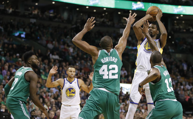 Nov 16, 2017; Boston, MA, USA; Golden State Warriors forward Kevin Durant (35) shoots the ballover Boston Celtics forward Al Horford (42) and forward Marcus Morris (13) in the second quarter at TD ...