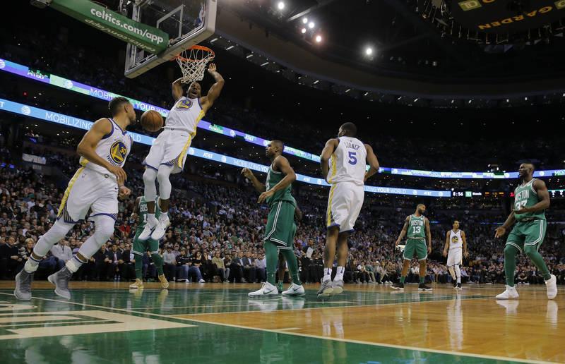 Nov 16, 2017; Boston, MA, USA; Golden State Warriors forward Andre Iguodala (9) makes the basket against the Boston Celtics in the second quarter at TD Garden. Mandatory Credit: David Butler II-US ...